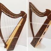 •New 27 String Celtic Lever Harp, Made With Seasoned Roos Wood, •Beautiful Designn, HandMade, Pure Treble And Warm Bass. •Comes With carry bag And Tunning Keys Extra String Set.  #babyharper #harps #harpist #harperseven #music #harpa #harper #lyraheartstrings #arpa #cheapprice #musicinstrument #celticharp #leverharps  #irishharp #folkmusik #music #harpmaker #harpplayer #harpa ##classicalmusic #classicalmusician #scottish  #lyre #lyreharp  #Irishharp #folkharp #music #harpmaker #harpist #classicalmusic
