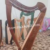 New 27 String Celtic Lever Harp This beautiful and professional Rosewood 27 strings Lever Harp is ideal for all players from the discerning beginner to the more experienced session musician. The quality materials used ensure a durable yet lightweight body. . •website: store.makeakilt.com •Email Us: sales@makeakilt.com  #harpist  #music #harpa #harper  #lyraheartstrings #arpa #cheapprice #musicinstrument #celticharp #leverharps  #irishharp #folkmusik #music #harpmaker #harpplayer  ##classicalmusic #classicalmusician #scottish  #lyre #lyreharp #folkharp #lapharp #harpist  #harp #babyharp #studentharps #harpforsale #harpmaster #harpteacher